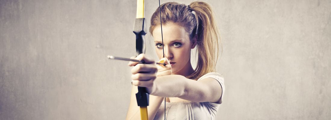 [Stock photo of Woman shooting arrow]